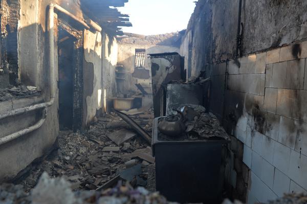 Дом в Донецкой области, разрушенный в результате артиллерийского обстрела
