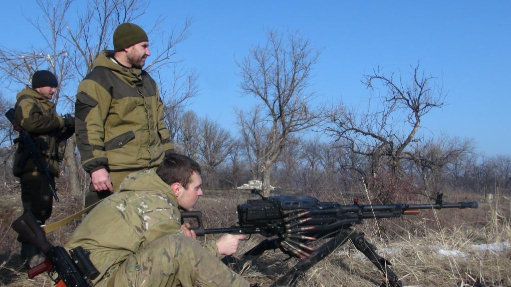 14 февраля. Бойцы армии провозглашенной ДНР на трассе между Углегорском и Дебальцево